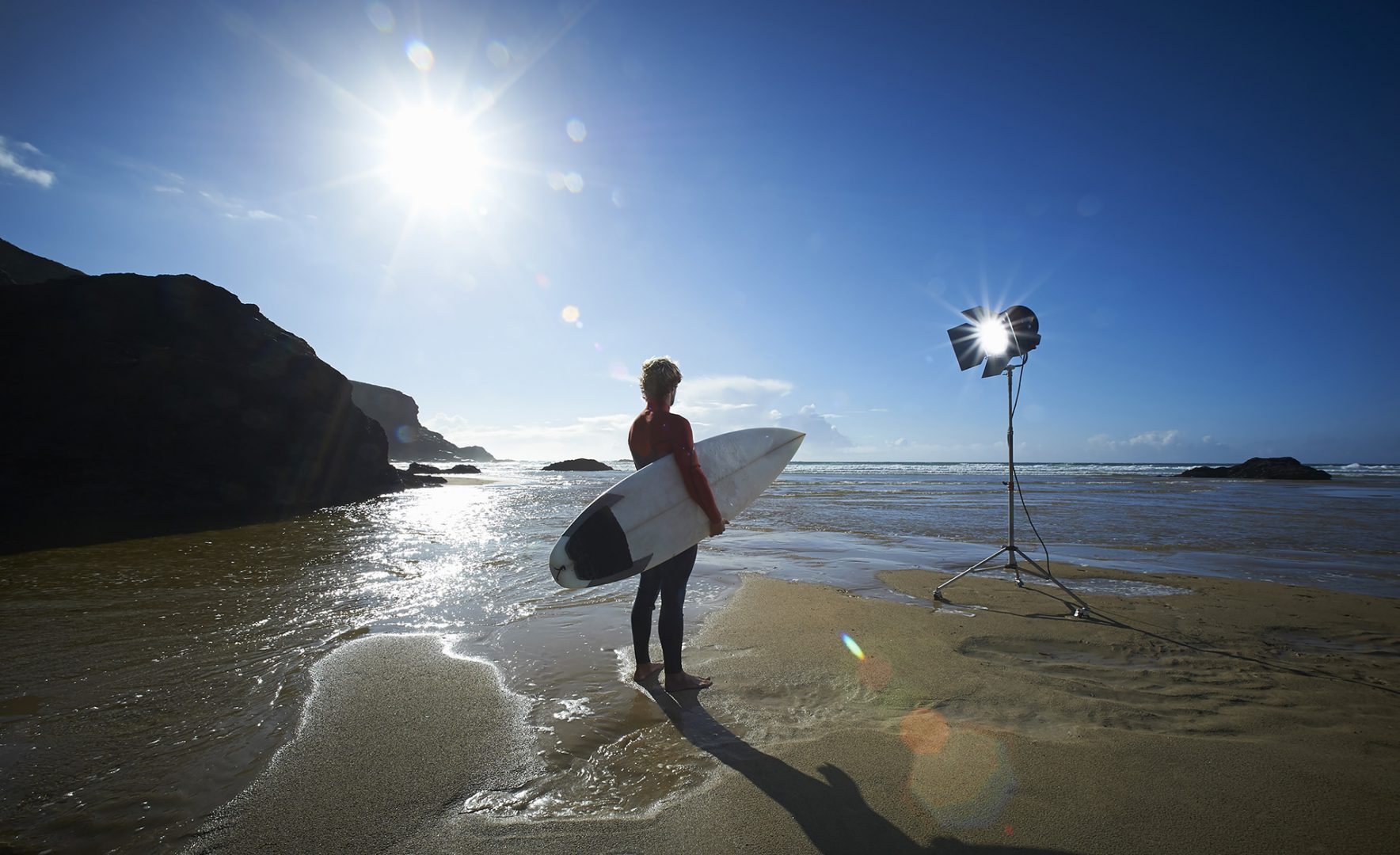 Photograph of a surfer on a Cornish beach